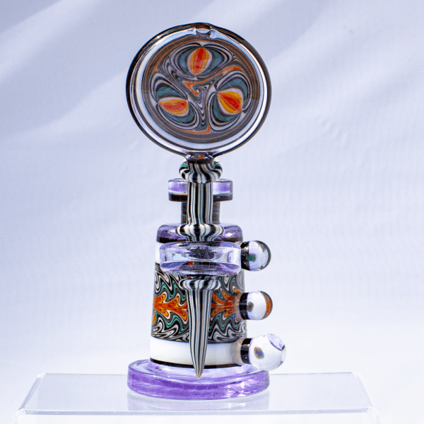 Front view displaying black-and-white striped stem, opal accents, and large, intricate mouthpiece on Hedman Headies dab rig.
