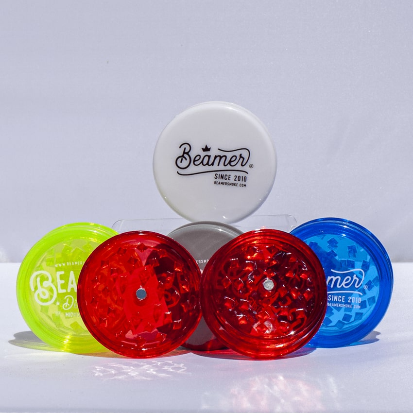 Assorted Colors of acrylic beamer-brand grinders for sale from 710 Pipes online head shop