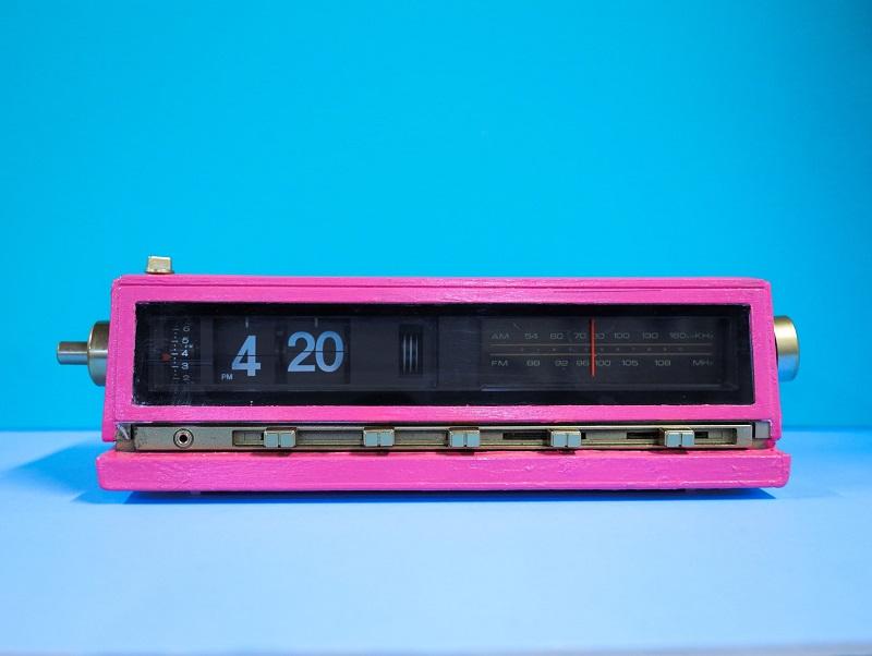 """4:20 PM"" displayed as time on retro neon-pink digital alarm clock"