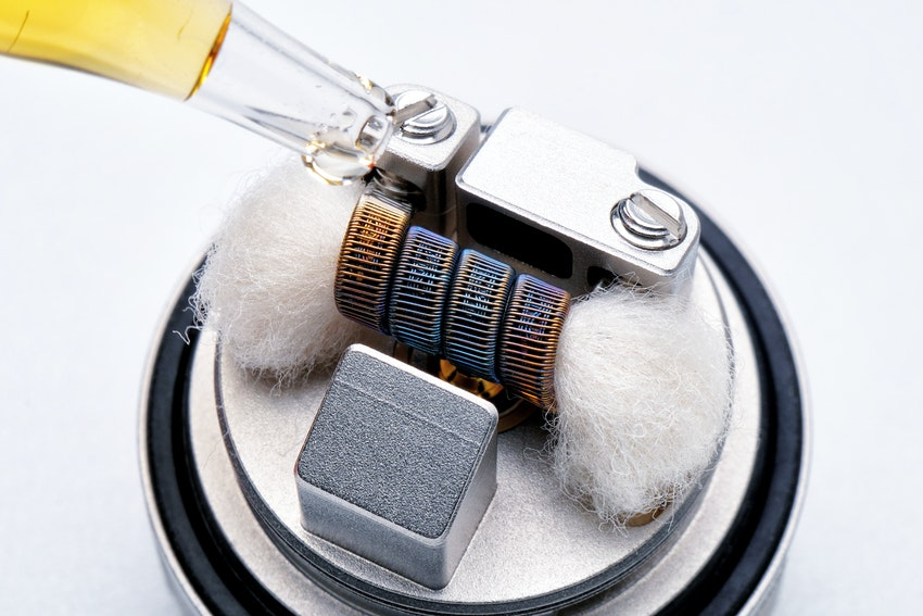 Interior view of vaporizer pen showing vape hardware including wick and coils
