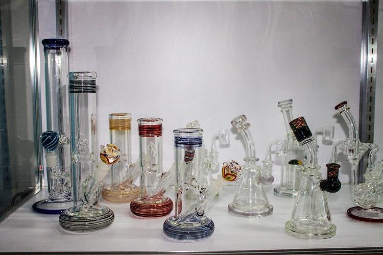 Multicolored bongs on shelf of 710 Pipes smoke shop