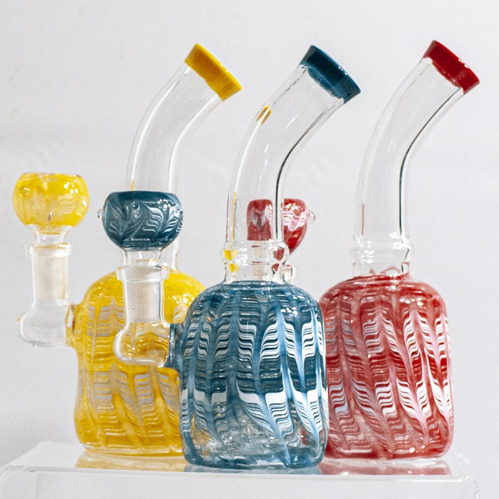 Several feathered miniature water pipes in assorted colors