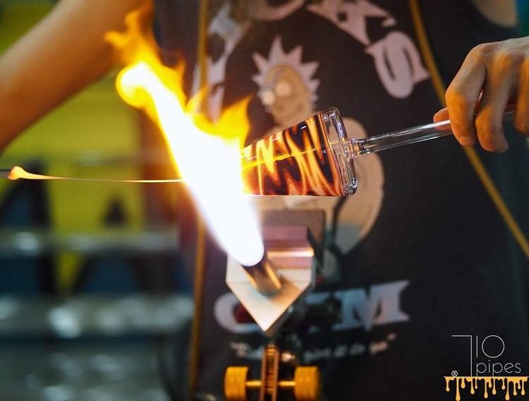 Denver glassblower Chris Bearden using blowtorch to create heady glass at 710 Studios in Northglenn, CO